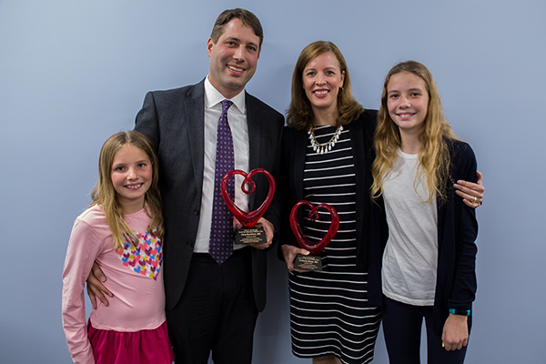 Kimberly Bower and Dr. Gary Buckholz, with their daughters