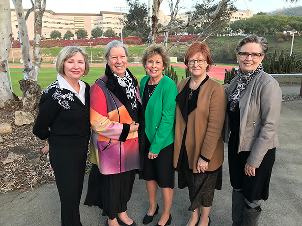 Christine Knutson and Jennifer Moore Ballentine, with representatives from the Doris A. Howell Foundation for Women's Health Research: from left, Kathleen Franklin, Dr. Carole Banka, and Carolyn Northrup.