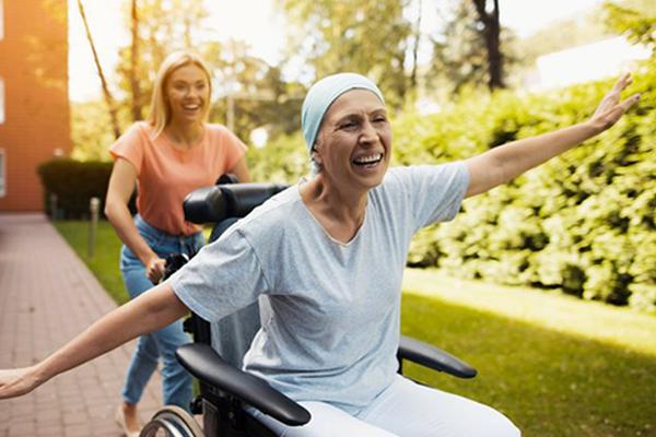 Cancer patient in wheelchair on walk