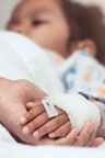 Doctor holding pediatric patient's hand