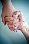 Social Worker holding Patients hand